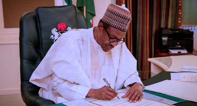 Buhari-signs-law