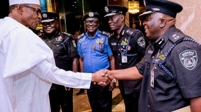 Buhari-and-Police3-653x365